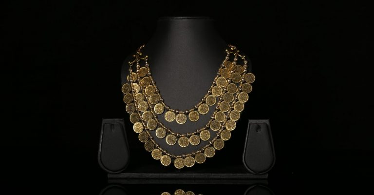 Old gold necklace on display