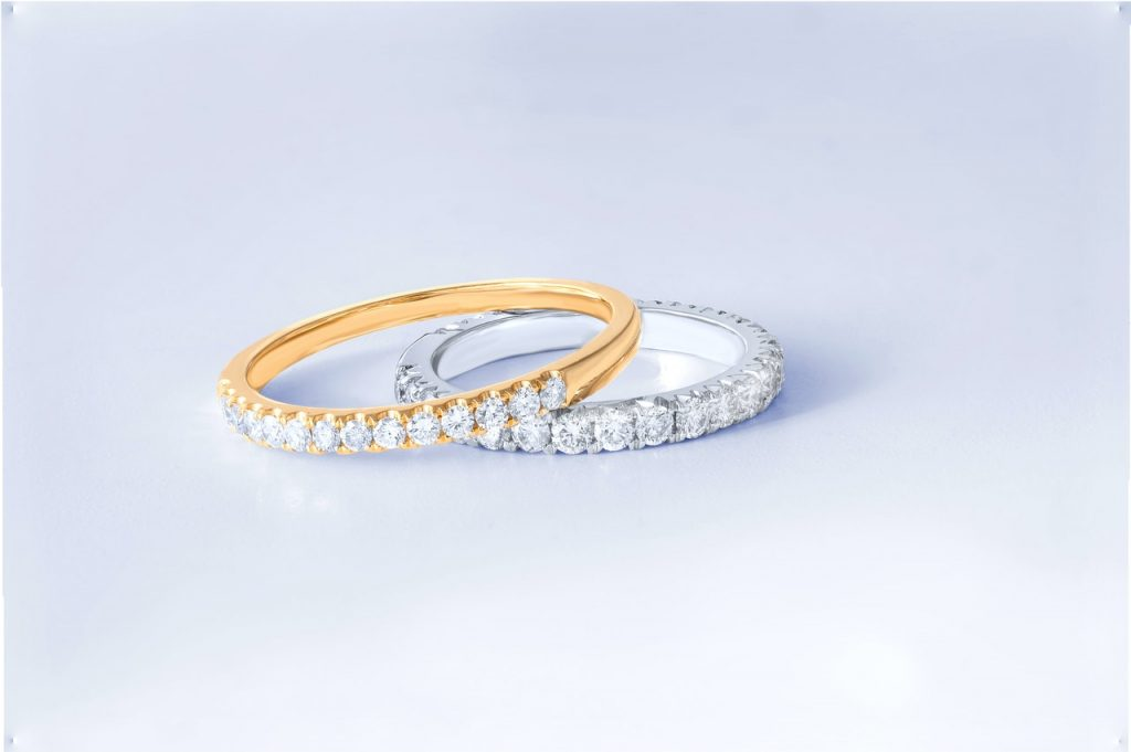gold and platinum rings with diamonds stacked on top of each other